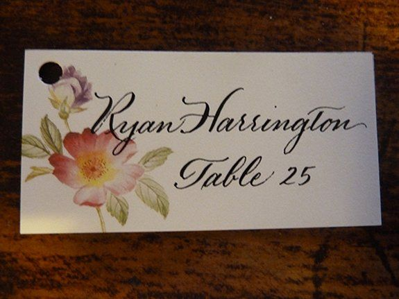 Hand lettered escort cards by Jan Hurst.  These were attached with ribbon to horseshoes for a...