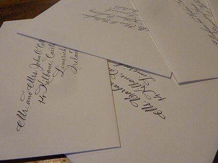 Sampling of wedding and save the date envelopes hand lettered by Jan Hurst.