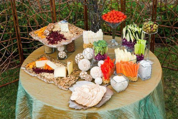 Elegant display of imported cheeses, fresh locally grown vegetables, dried fruits and nuts. Delish!