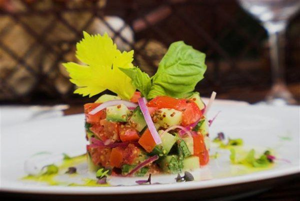 Cucumber Tomato Stack: With diced cucumbers, roma tomatoes, fresh basil, a sprinkling of red onions,...
