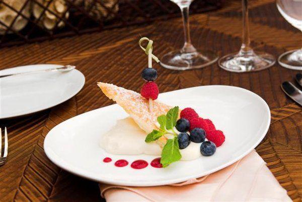Deconstructed Napoleon: Fresh seasonal berries, layered with puff pastry and light vanilla custard....