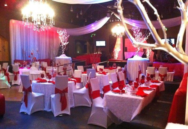 WEdding reception designed with crystal trees and elegant table linens to set the mood for this...