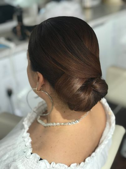 Smooth and silky updo by Breana