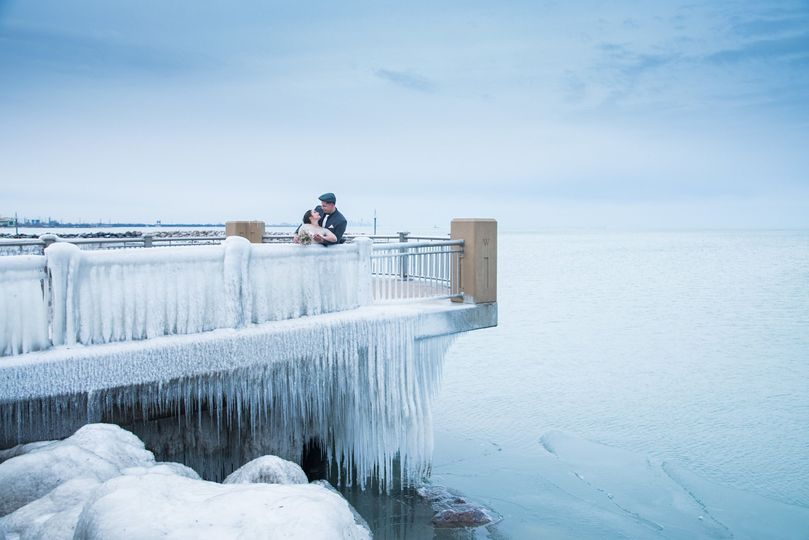 Happy couple by the frozen water - VisualEtiquette