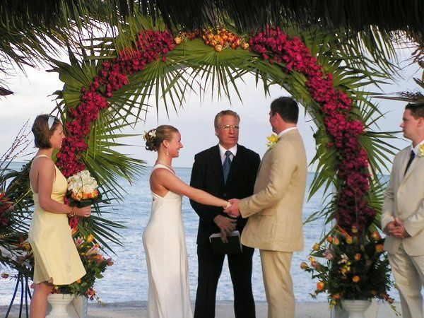 Ceremony under arch at beach