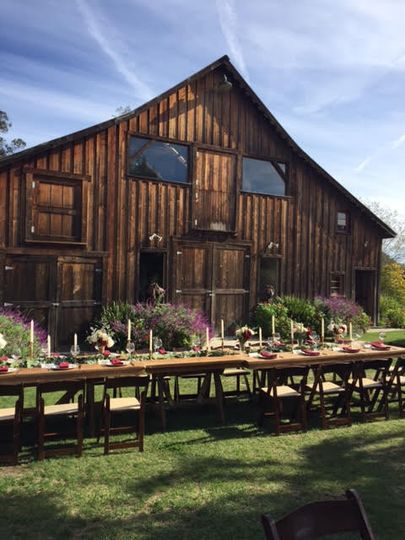 Beautiful head table set up in front of the barn