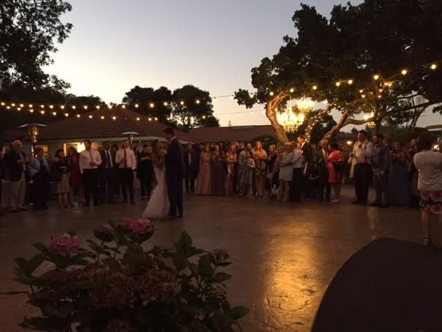 String lighting adorns Rancho Soquel's dance floor for a glow filled first dance