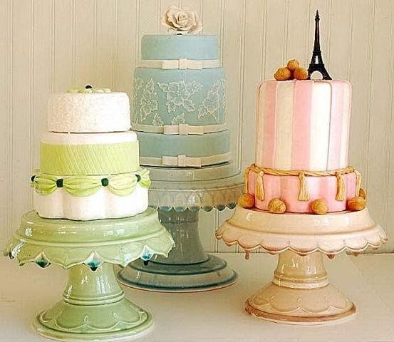 Little centerpiece cakes on matching hand made Clara French cake plates.