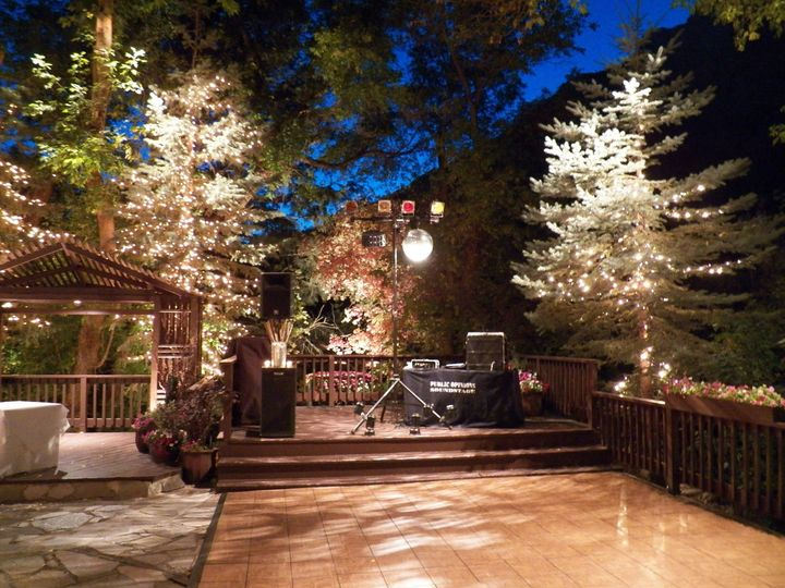 Lit up patio with dance floor, reception sound system
