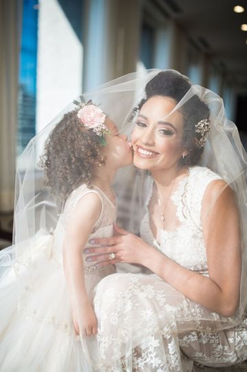 Natural hair updo, glowing bride makeup