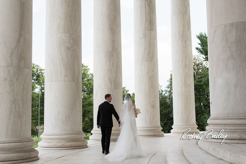 Newlyweds by the columns