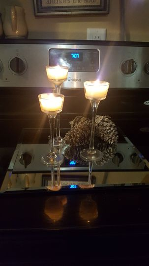 Centerpieces with or without mirrors and pine cones.