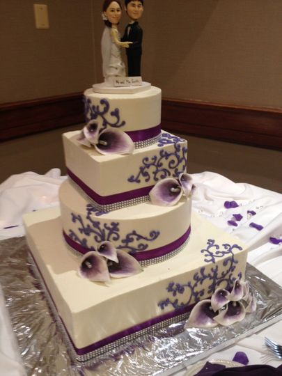 4-tier wedding cake with purple details