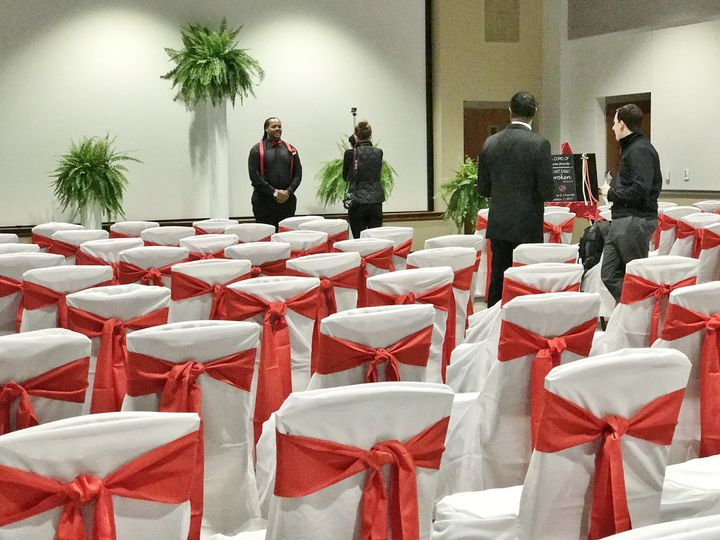 White chairs with red bows