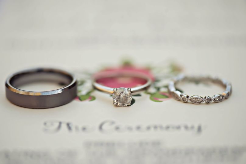 DIY ceremony programs with gorgeous rings on top! Photo Credit: Cindy McFarland Photography
