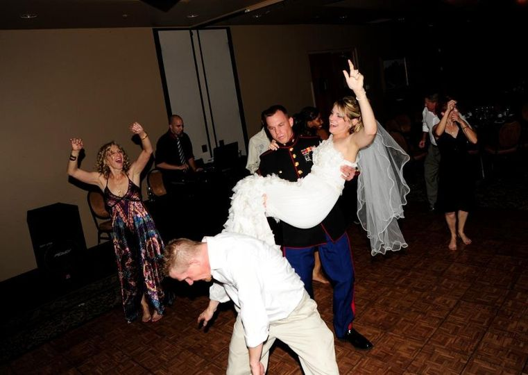 Dancing couple with guests