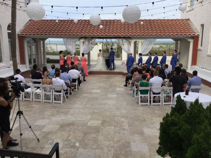 A sleek outdoor ceremony