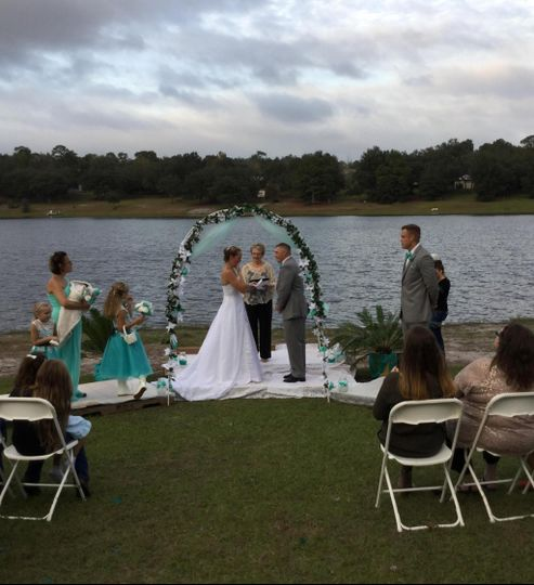 Waterfront ceremony with arch