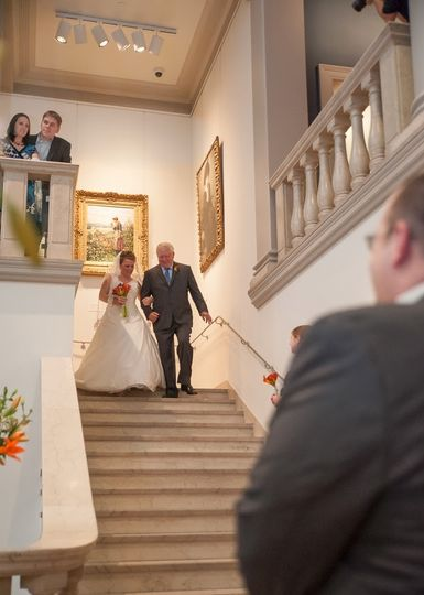 Bride and escort walking down the stairs