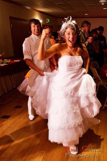 A happy bride leading the conga line!