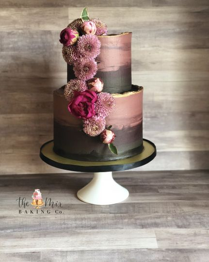 Deep and dark romance watercolour buttercream cake with floral cascade
