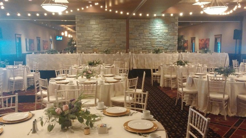 hall w bistro lights charger plates rented white