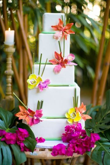 White wedding cake with summer flowers