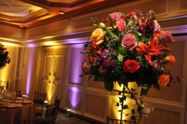 Water's Edge at Giovanni's wedding, yellow and purple up-lighting, centerpiece pinspotting.