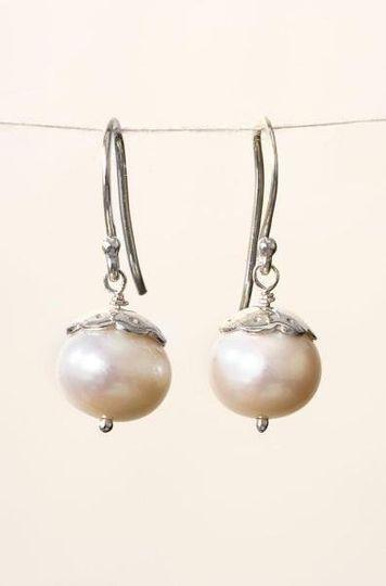 Pearl Drop Earring -- Ivory/Silver Delicate freshwater pearl drop earrings with sterling silver...