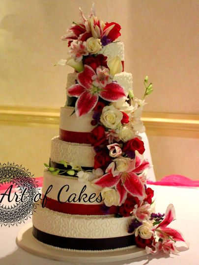 Tall cake with cascading flowers