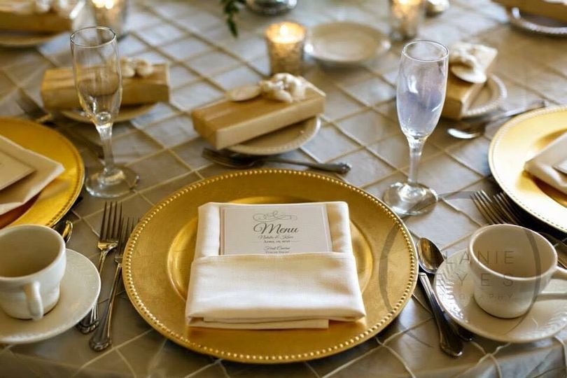 Ivory pintuck linen with Gold chargers seen here.