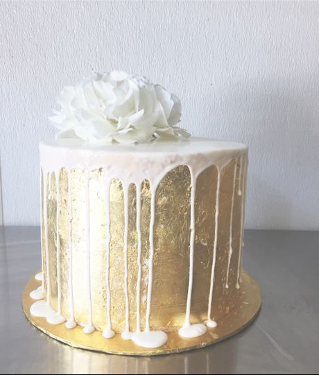 Golden cake dripping in white