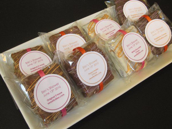 An assorted selection of s'mores with magenta and orange accents.