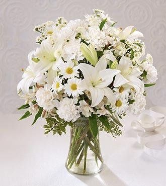 Elegant vase of lillies and other great flowers