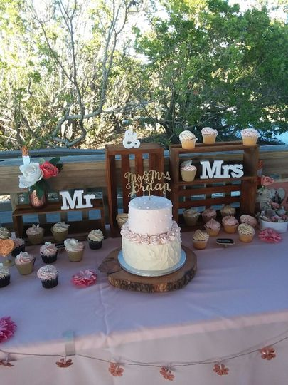 Cake and cupcake table at a small wedding