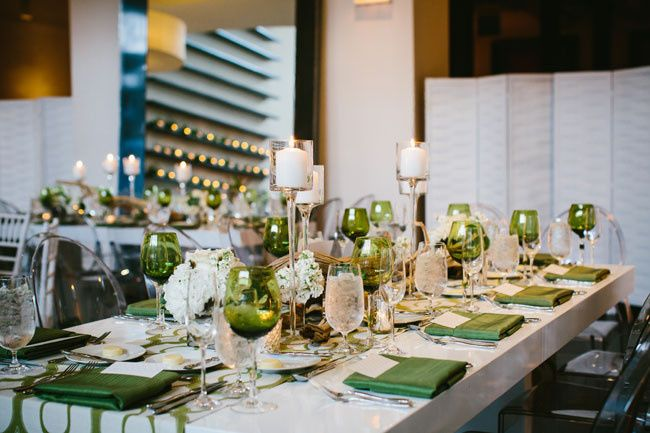 Long table setup with candle and bouquet centerpiece