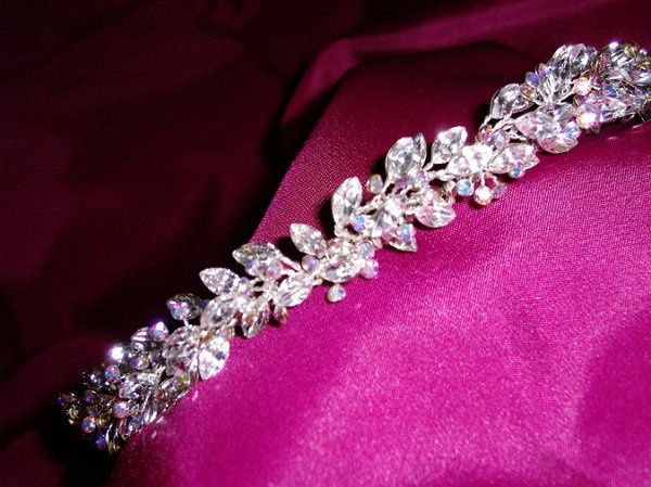 Beautiful hues of pink, blue, yellow and green illuminate from the petite AB rhinestones. Marquise...