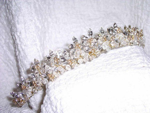 This Tiara is stunning with its gold tones and swarovski crystals and marquise cut rhinestones....