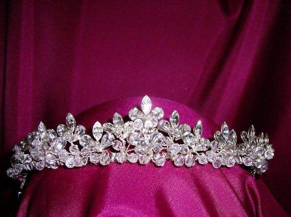This regal headpiece has both marquise and pear cut rhinestones set with silver bead centers. This...