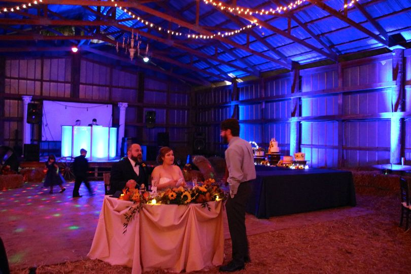 Fairy lights and uplighting in the barn