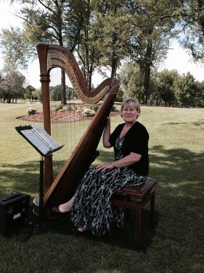 Debbie Beck and her harp