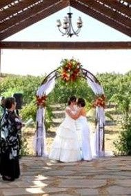 This couple filled their wedding arch with love in their vineyard wedding