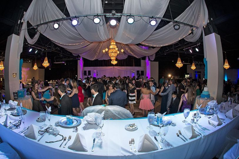 Grand ballroom accommodates 400 people with a large stage and dance floor. Typically used for formal...