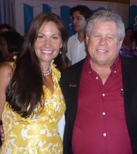 Lindsey Hoffman from Ultra Tech Travel pictured with Mr. Gordon (Butch) Stewart owner of Sandals and...