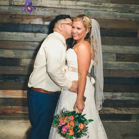 Kiss on the cheek Ali Rene Photography