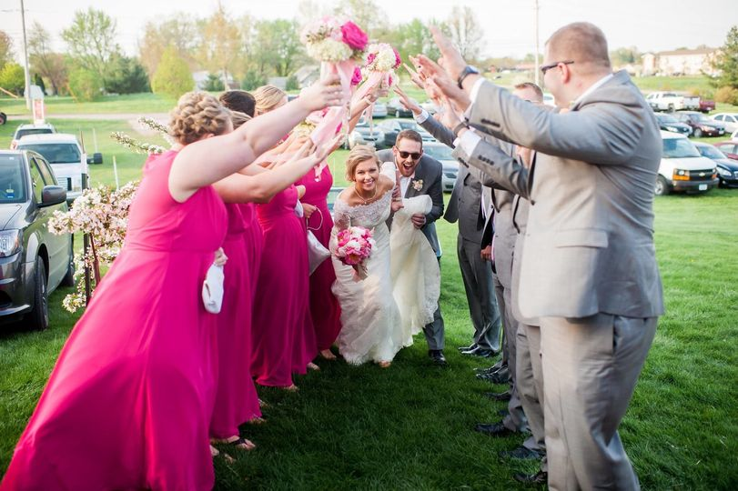 Guests cheering for newlyweds
