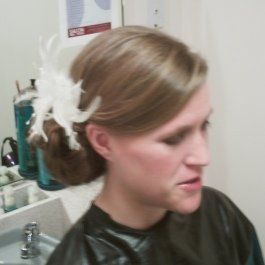 Updo with feather accessory