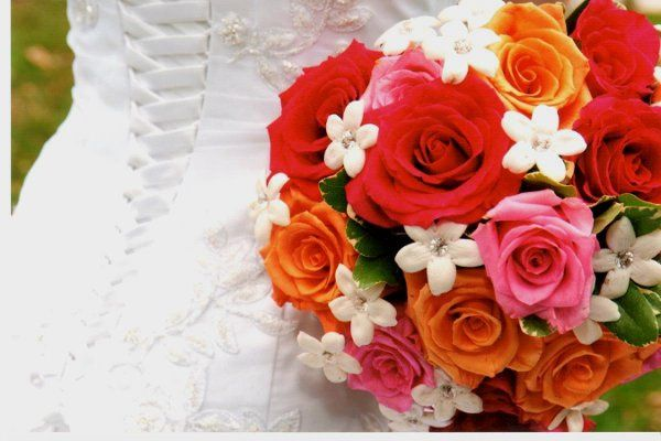 hot colored roses and stephanotis nosegay