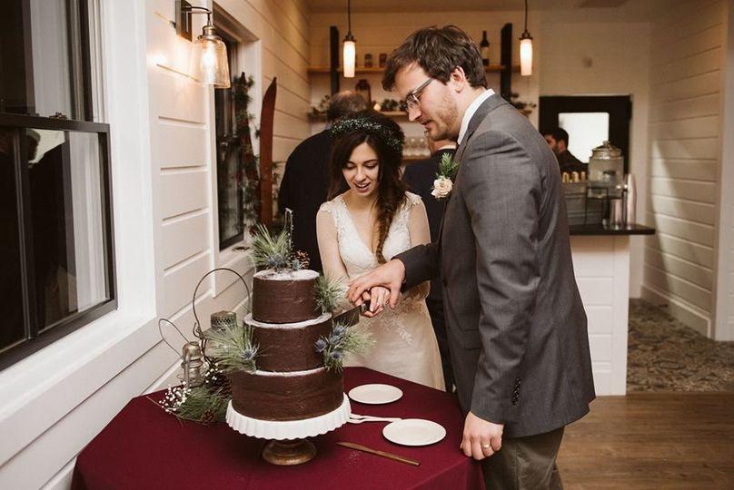 Couple with their wedding cake
