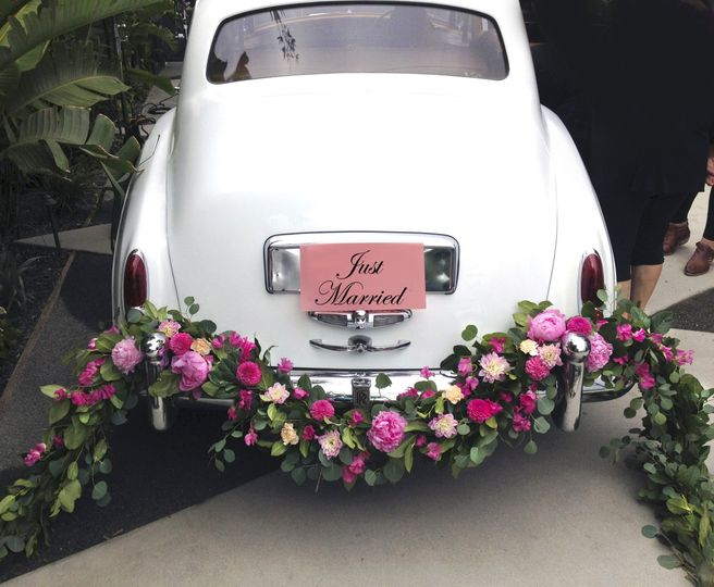 just married with flower garland 2
